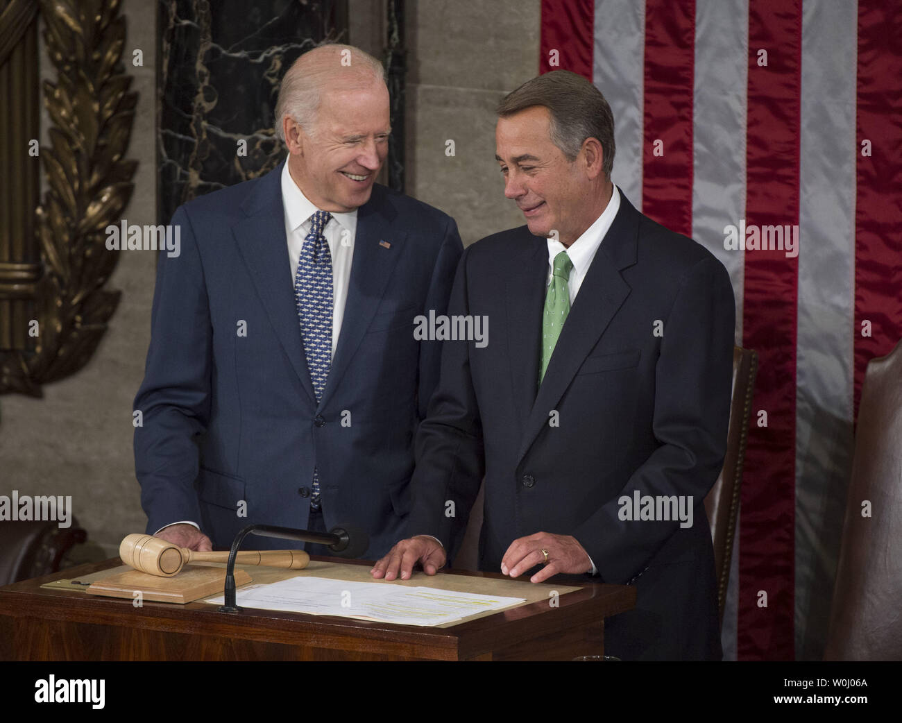 Vice President Joe Biden (L) talks with Speaker John Boehner (R-OH) prior to Pope Francis addressing a Joint Meeting of Congress at the U.S. Capitol Building in Washington, D.C. on September 24, 2015. Photo by Kevin Dietsch/UPI - Stock Image
