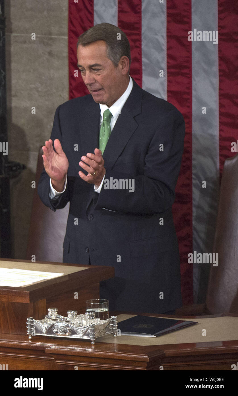 Speaker of the House John Boehner (R-OH) applauds a Pope Francis delivers an address to Congress, at the U.S. Capitol Building in Washington, D.C. on September 24, 2015. Boehner announced today, September 25, that he will step down as Speaker and resign from Congress at the end of October. Boehner said he decided this morning to announce his plans to resign from Congress. Photo by Kevin Dietsch/UPI - Stock Image