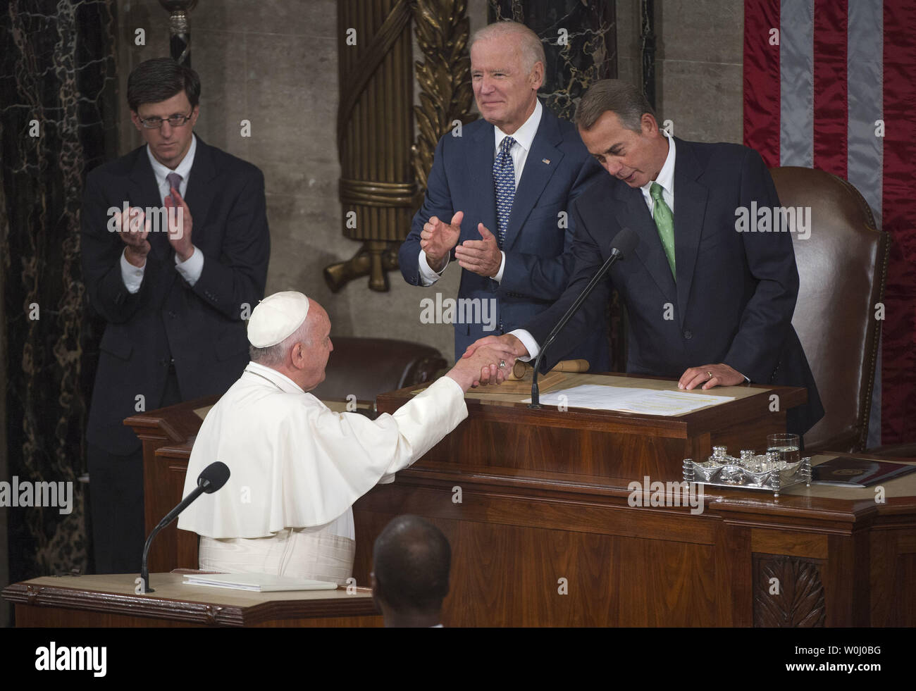 Speaker of the House John Boehner (R-OH) shakes hands with Pope Francis, at the U.S. Capitol Building in Washington, D.C. on September 24, 2015. Boehner announced today, September 25, that he will step down as Speaker and resign from Congress at the end of October. Boehner said he decided this morning to announce his plans to resign from Congress. Photo by Kevin Dietsch/UPI - Stock Image
