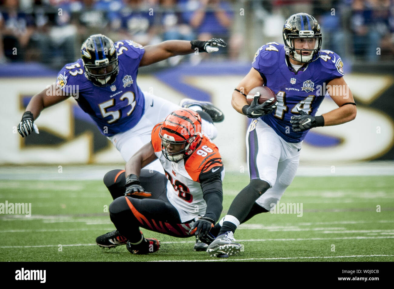 Baltimore Raven fullback Kyle Juszczyk breaks a tackle during the third  quarter against the Cincinatti Bengals