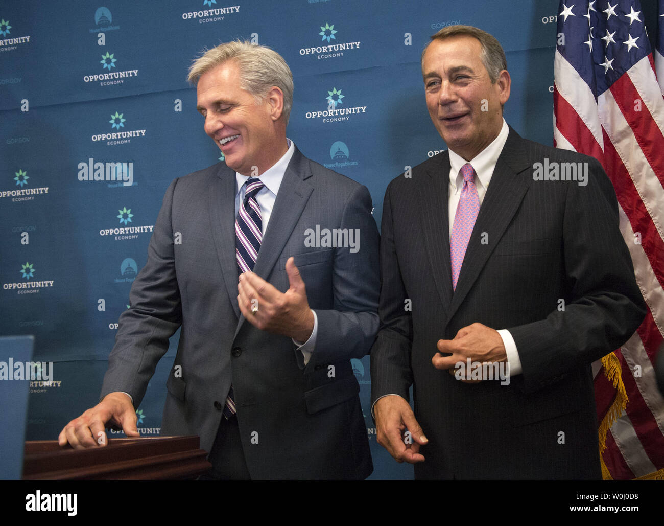 House Majority Leader Kevin McCarthy (R-SD) (L) and Speaker of the House John Boehner (R-OH) laugh together in response to a reporter's question on Boehner's recent announcement to step down, during a press conference on Capitol Hill in Washington, D.C. on September 29, 2015. Photo by Kevin Dietsch/UPI - Stock Image