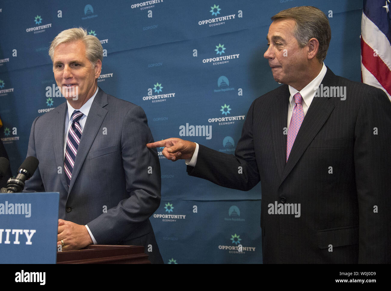Speaker of the House John Boehner (R-OH) (R) points to House Majority Leader Kevin McCarthy (R-SD) in response to a reporter's question on Boehner's recent announcement to step down, during a press conference on Capitol Hill in Washington, D.C. on September 29, 2015. Photo by Kevin Dietsch/UPI - Stock Image