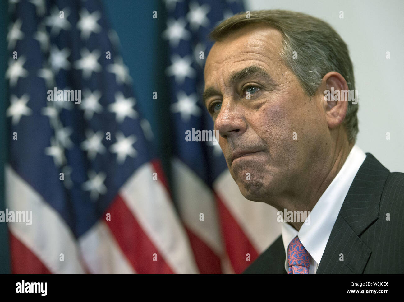 Speaker of the House John Boehner (R-OH) listens during a weekly press conference on Capitol Hill in Washington, D.C. on September 29, 2015. Photo by Kevin Dietsch/UPI - Stock Image