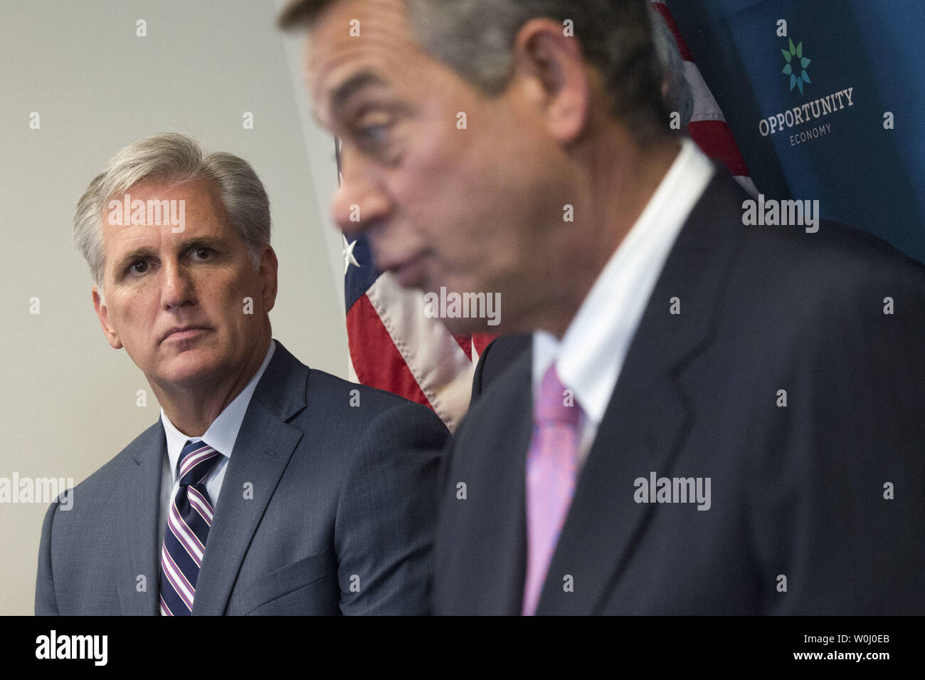 House Majority Leader Kevin McCarthy (R-SD) (L) watches as Speaker of the House John Boehner (R-OH) speaks during a weekly press conference on Capitol Hill in Washington, D.C. on September 29, 2015. Photo by Kevin Dietsch/UPI - Stock Image
