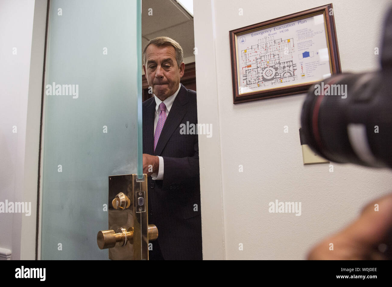 Speaker of the House John Boehner (R-OH) walks back into a press conference on Capitol Hill in Washington, D.C. on September 29, 2015. Photo by Kevin Dietsch/UPI - Stock Image