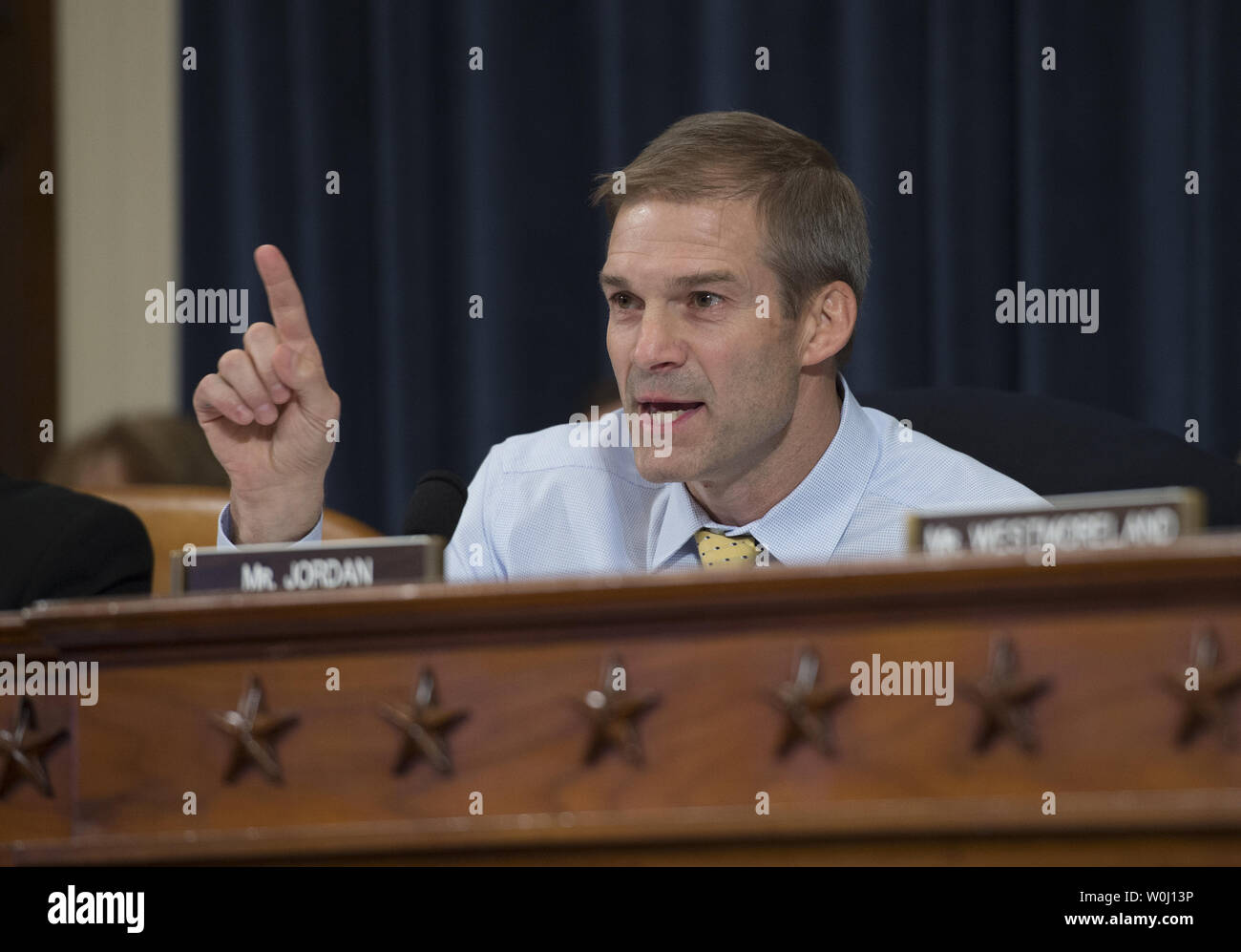 Rep. Jim Jordan, (R-OH), questions former Secretary of State and Democratic presidential hopeful Hillary Clinton as she testifies before the Select Committee on Benghazi on Capitol Hill in Washington DC, October 22, 2015. Clinton appears in a long-awaited appearance to answer questions about the 2012 deadly attack on the U.S. diplomatic mission in Benghazi, Libya. Photo by Molly Riley/UPI - Stock Image
