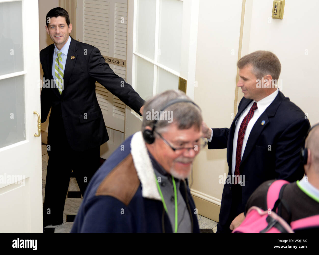 Rep. Paul Ryan (R-WI) enters a doorway in the basement of the U.S. Capitol, as he walks past tourists, October 27, 2015, in Washington, DC. Paul is expected to take the Speaker's gavel, succeeding Rep. John Boehner (R-OH), who is stepping down.      Photo by Mike Theiler/UPI - Stock Image