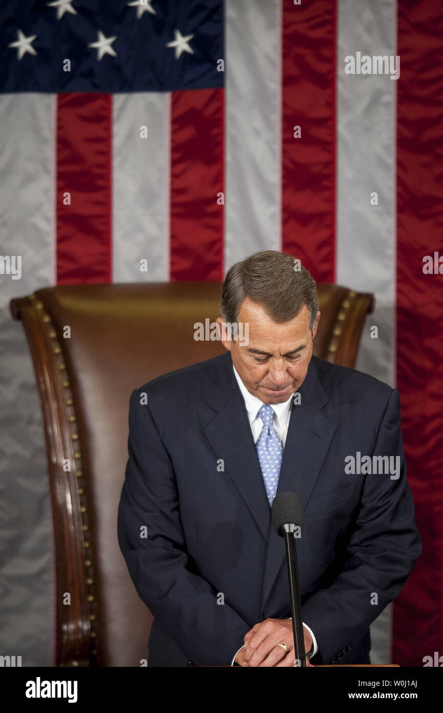The day before he is to retire from Congress, Speaker of the House John Boehner (R-OH) bows his head as the House chaplin delivers the opening prayer in the House of Representatives on October 29, 2015 in Washington, D.C. Following Boehner's farewell address, the House of Representatives will vote on Boehner's replacement for Speaker. Photo by Pete Marovich/UPI - Stock Image