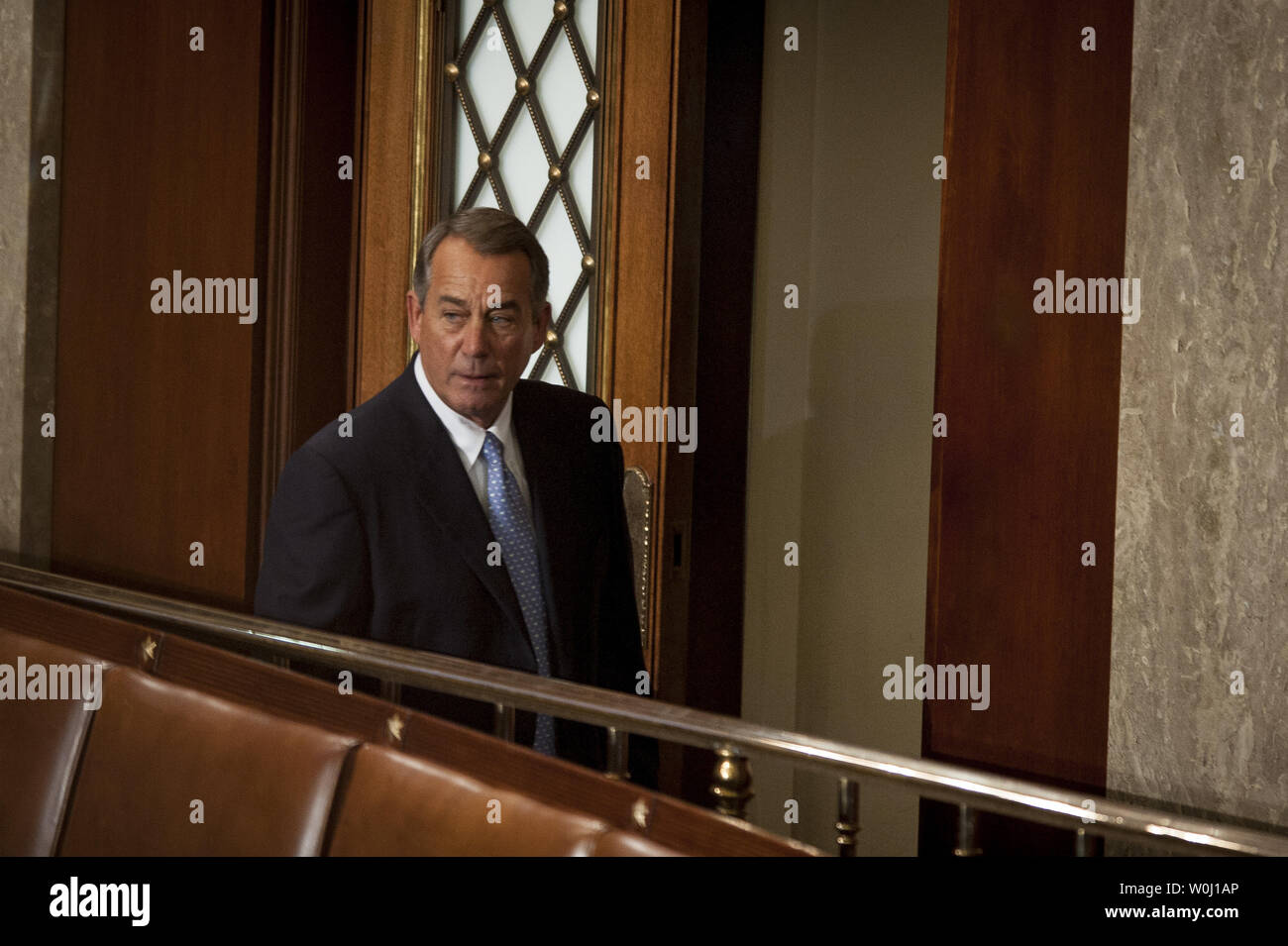 The day before he is to retire from Congress, Speaker of the House John Boehner (R-OH) looks over the House of Representatives as he leaves during a quorum call on October 29, 2015 in Washington, D.C. Following Boehner's farewell address, the House of Representatives will vote on Boehner's replacement for Speaker. Photo by Pete Marovich/UPI - Stock Image