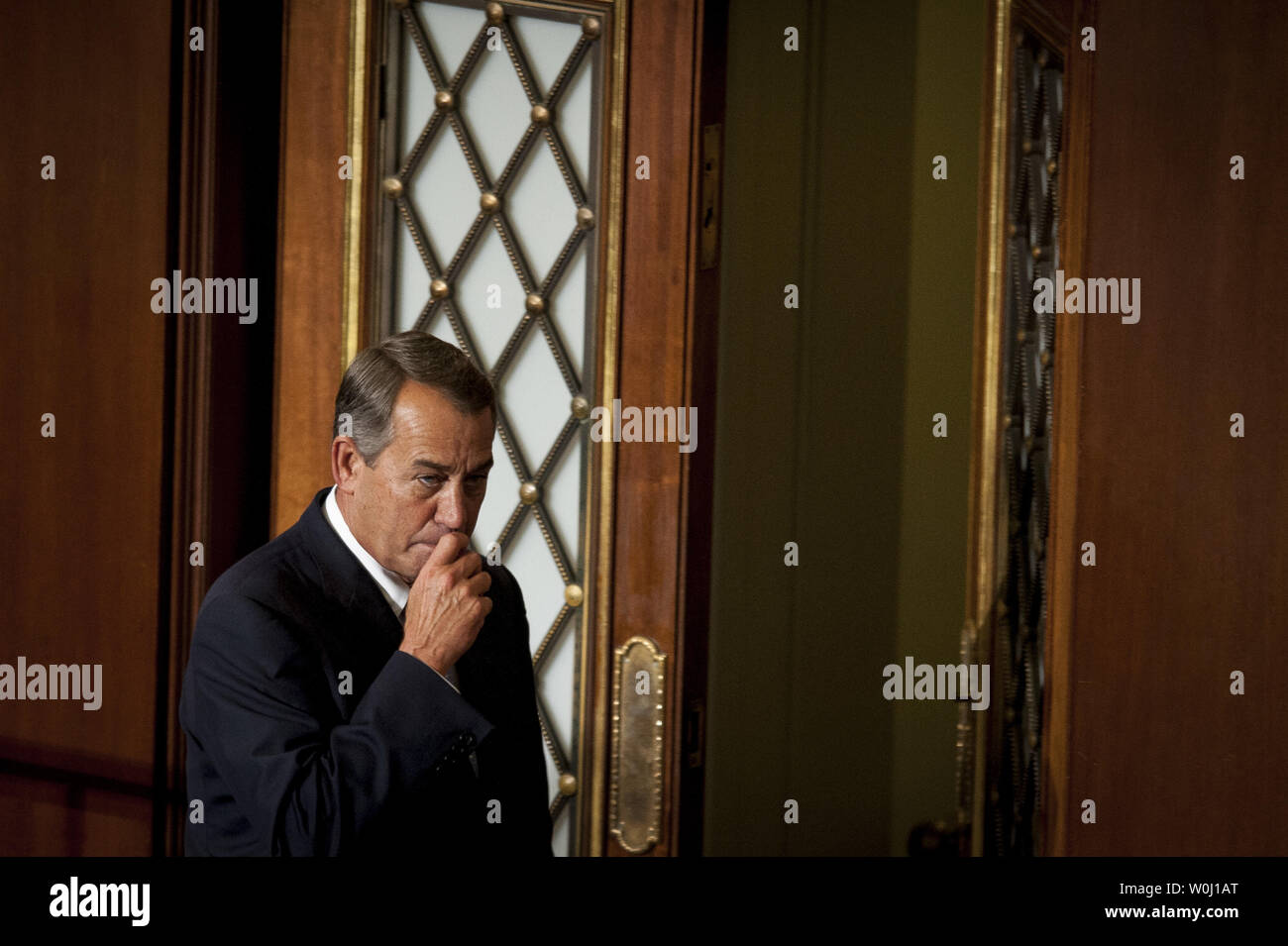 The day before he is to retire from Congress, Speaker of the House John Boehner (R-OH) leaves during a quorum call on October 29, 2015 in Washington, D.C. Following Boehner's farewell address, the House of Representatives will vote on Boehner's replacement for Speaker. Photo by Pete Marovich/UPI - Stock Image