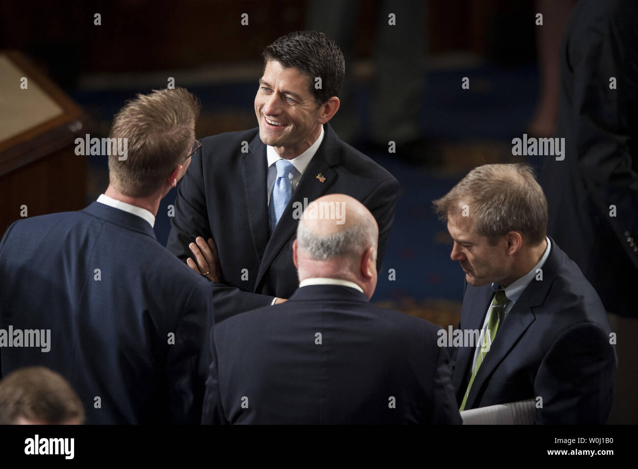 Republican caucus nominee for Speaker of the House, Rep. Paul Ryan (R-WI) is greeted by fellow Members of Congress on the floor  of the House of Representatives on October 29, 2015 in Washington, D.C.   Earlier, the outgoing Speaker, Rep. John Boehner (R-OH), gave his farewell address to Congress. He is retiring on October 30, 2015. Photo by Pete Marovich/UPI - Stock Image