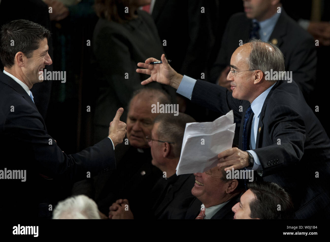 Republican caucus nominee for Speaker of the House, Rep. Paul Ryan (R-WI) is greeted by fellow Members of Congress on the floor  of the House of Representatives on on October 29, 2015 in Washington, D.C. Earlier the outgoing Speaker, Rep. John Boehner (R-OH), gave his farewell address to Congress. He is retiring on October 30, 2015. Photo by Pete Marovich/UPI - Stock Image