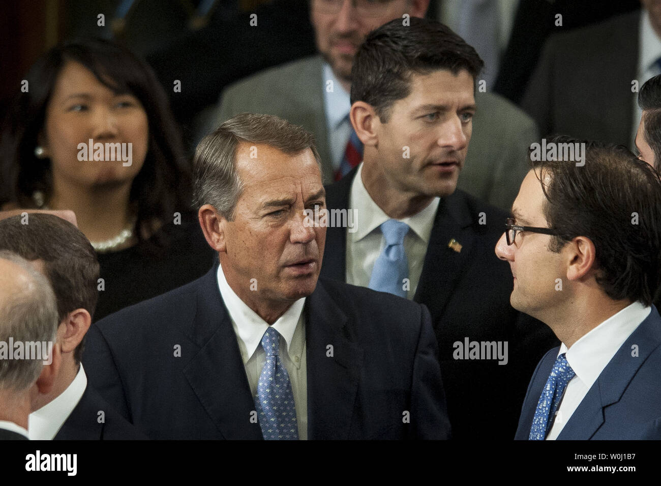 Speaker of the House John Boehner (R-OH) mingles with other Members of Congress as Republican caucus nominee for Speaker of the House, Rep. Paul Ryan (R-WI) stands nearby on the floor of the House of Representatives on on October 29, 2015 in Washington, D.C.  Photo by Pete Marovich/UPI - Stock Image