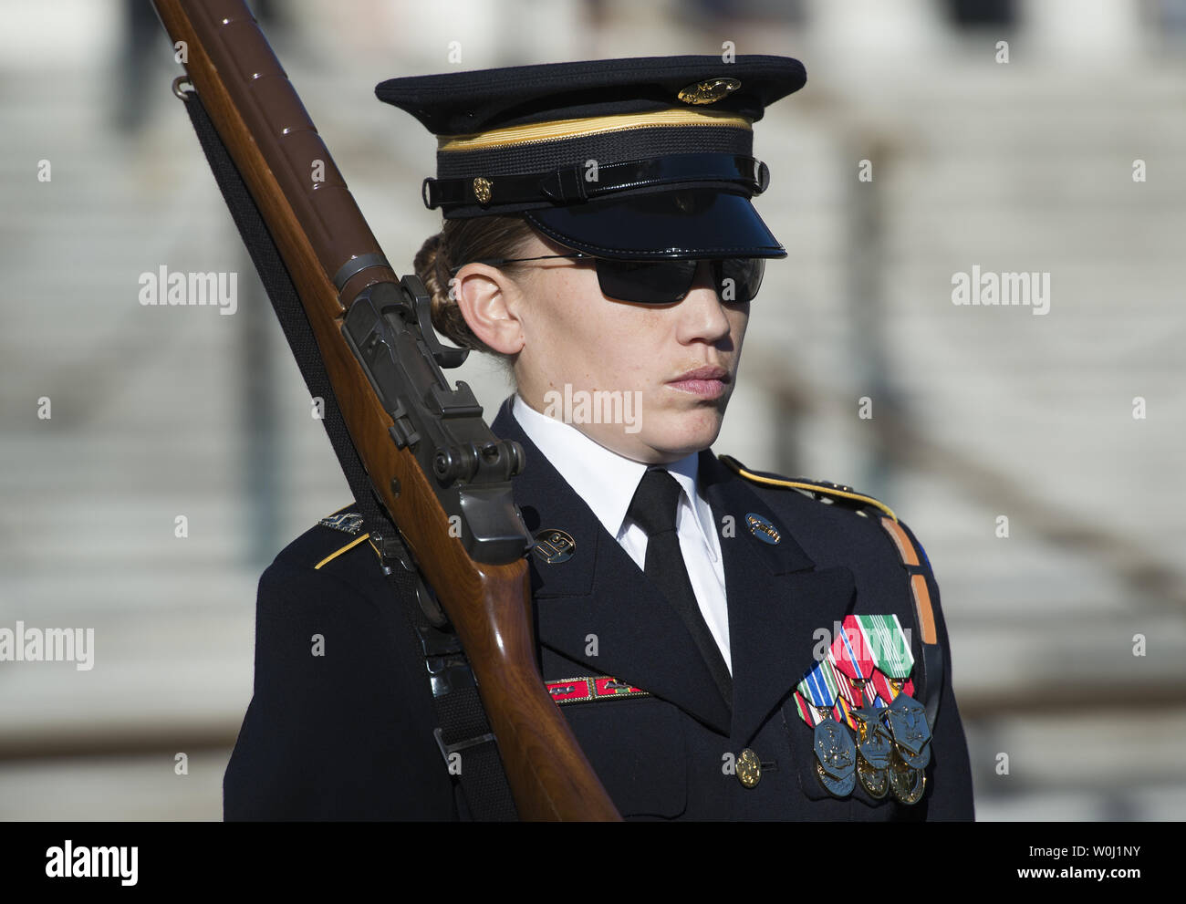 Sgt. Ruth A. Hanks, who is training to receive her Tomb Badge, guards the Tomb of the Unkowns at Arlington National Cemetery in Arlington, Va., November 11, 2015.  There have been only 3 female Tomb Guards who earned their Tomb Badge.  Photo by Molly Riley/UPI - Stock Image