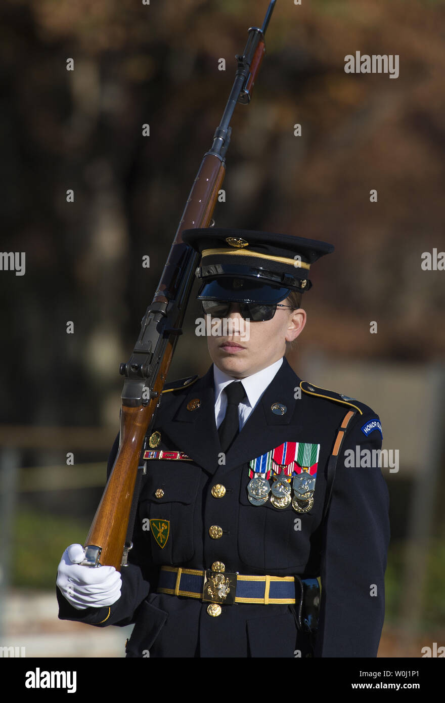Sgt. Ruth A. Hanks, who is training to receive her Tomb Badge, guards the Tomb of the Unkowns at Arlington National Cemetery in Arlington, Va., November 11, 2015.  There have been only 3 female Tomb Guards who have earned their Tomb Badge.  Photo by Molly Riley/UPI - Stock Image