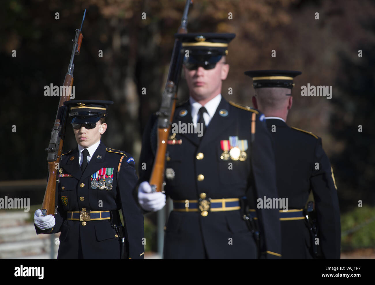 Sgt. Ruth A. Hanks, who is training to receive her Tomb Badge, participates in the changing of the guard at the Tomb of the Unkowns at Arlington National Cemetery in Arlington, Va., November 11, 2015.  There have been only 3 female Tomb Guards who have earned their Tomb Badge.  Photo by Molly Riley/UPI - Stock Image