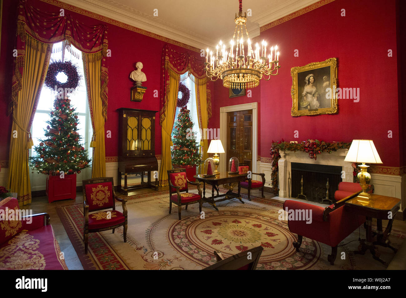 The Red Room is seen decorated during a holiday tour at the White House in Washington, D.C. on December 2, 2015. This year's team is 'A Timeless Tradition, and reflects long-held traditions cherished across America and commemorates extradorinaiy moments that help shaped the county. Photo by Kevin Dietsch/UPI. - Stock Image