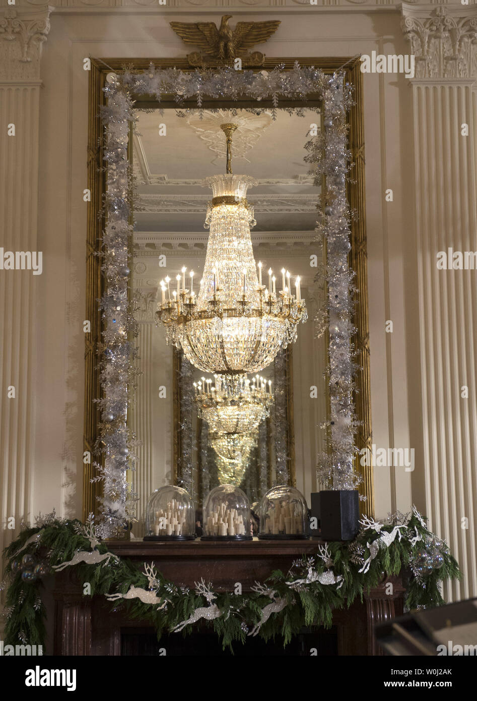 Decorations are seen in the East Room during a holiday tour at the White House in Washington, D.C. on December 2, 2015. This year's team is 'A Timeless Tradition, and reflects long-held traditions cherished across America and commemorates extradorinaiy moments that help shaped the county. Photo by Kevin Dietsch/UPI. - Stock Image