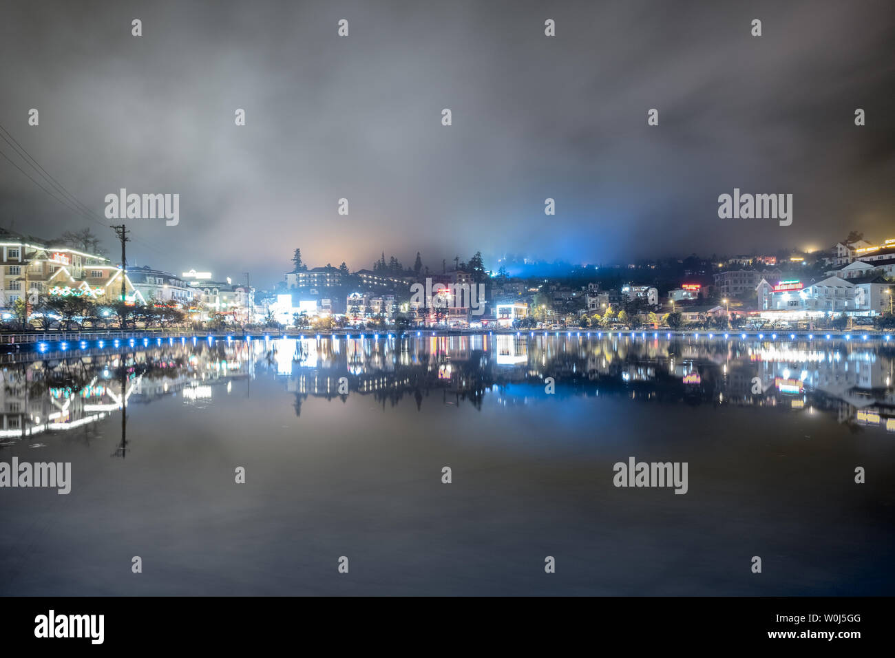 Sapa, Vietnam : Sep 07 2017 : Viewpoint city lighting decoration in lagoon foggy at night - Stock Image