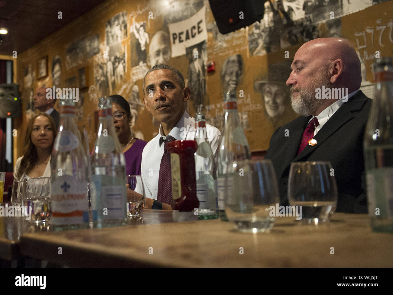 President Barack Obama speaks to the media after having lunch with formerly incarcerated individuals who have received commutations, at Bus Boys and Poets restaurant in Washington, D.C. on March 30, 2016. Obama commented 61 additional sentences today. Photo by Kevin Dietsch/UPI Stock Photo