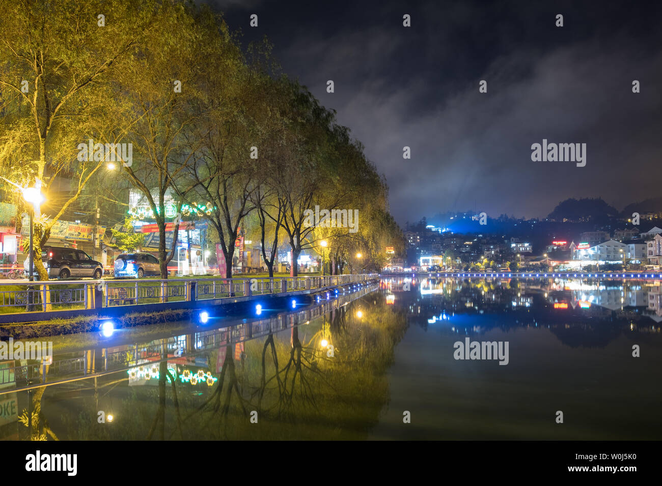 Sapa, Vietnam : Sep 07 2017 : Viewpoint lagoon decorated beautiful lights with willows tree in Sapa city, Vietnam - Stock Image