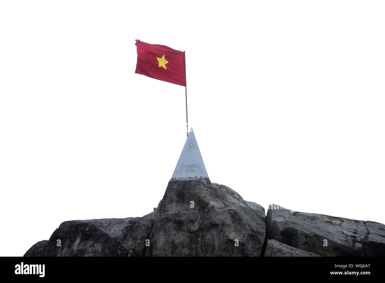 Sapa, Vietnam - Sep 08 2017 : On top Fansipan mountain with flag vietnam waving and monument on stone at 3143 over sea level - Stock Image