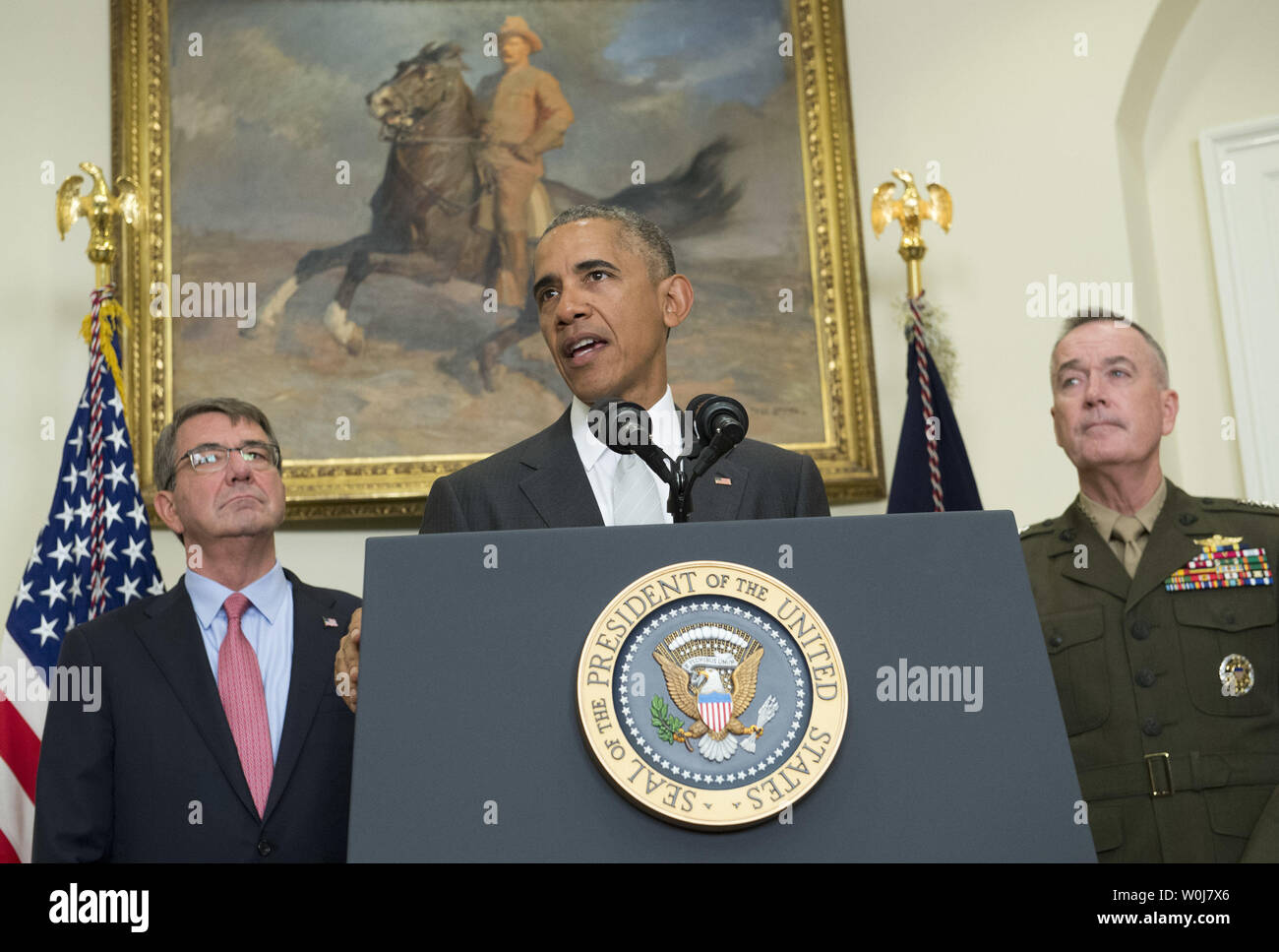 President Barack Obama, joined by Defense Secretary Ash Carter (L) and Chairman of the Joint Chiefs of Staff Marine Gen. Joseph Dunford, announces that the United States will leave more troops in Afghanistan than originally planned through the end of the year, in the Roosevelt Room at the White House in Washington, D.C. on July 6, 2016. Obama announced a draw down of troops to 8,400 by the end of his administration. Photo by Kevin Dietsch/UPI Stock Photo
