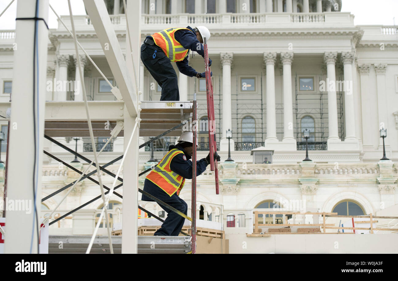 Construction workers build the center media riser as work continues on the West Front of the Capitol in preparation of the Presidential Inauguration, at the U.S. Capitol Building in Washington, D.C. on December 8, 2016. Donald Trump will be sworn-in as Presidential on January 20, 2016. Photo by Kevin Dietsch/UPI - Stock Image