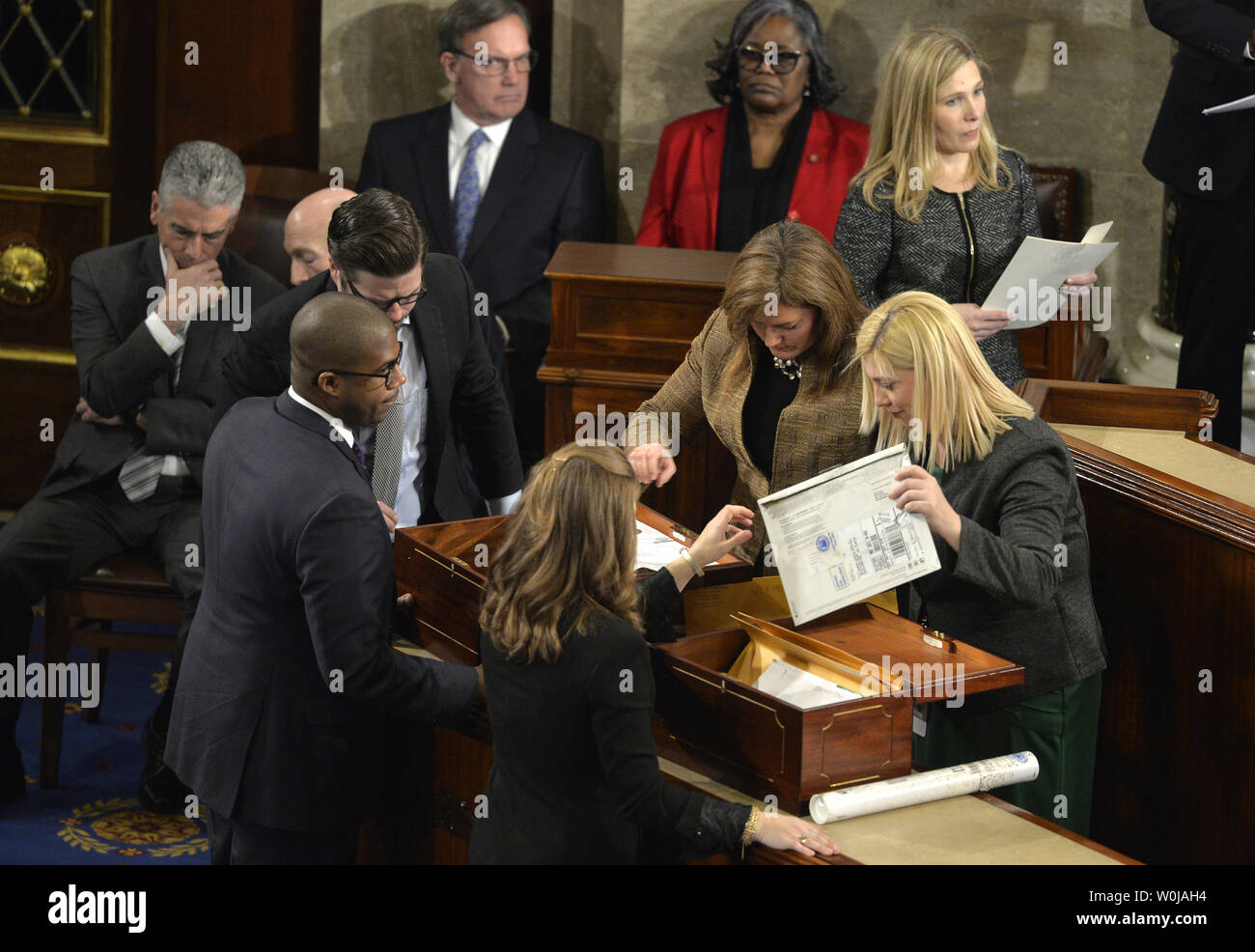Congressional staff unseal envelopes from the two ballot boxes that contain 50 states and District of Columbia Electoral College votes on the floor of the House to be counted and validated at the U.S. Capitol, January 6, 2017, in Washington, DC. The procedure, established by the Constitution, and presided over by Vice President Joe Biden and Speaker Paul Ryan declared and finalized Donald J. Trump and Mike Pence as president and vice president.                 Photo by Mike Theiler/UPI - Stock Image