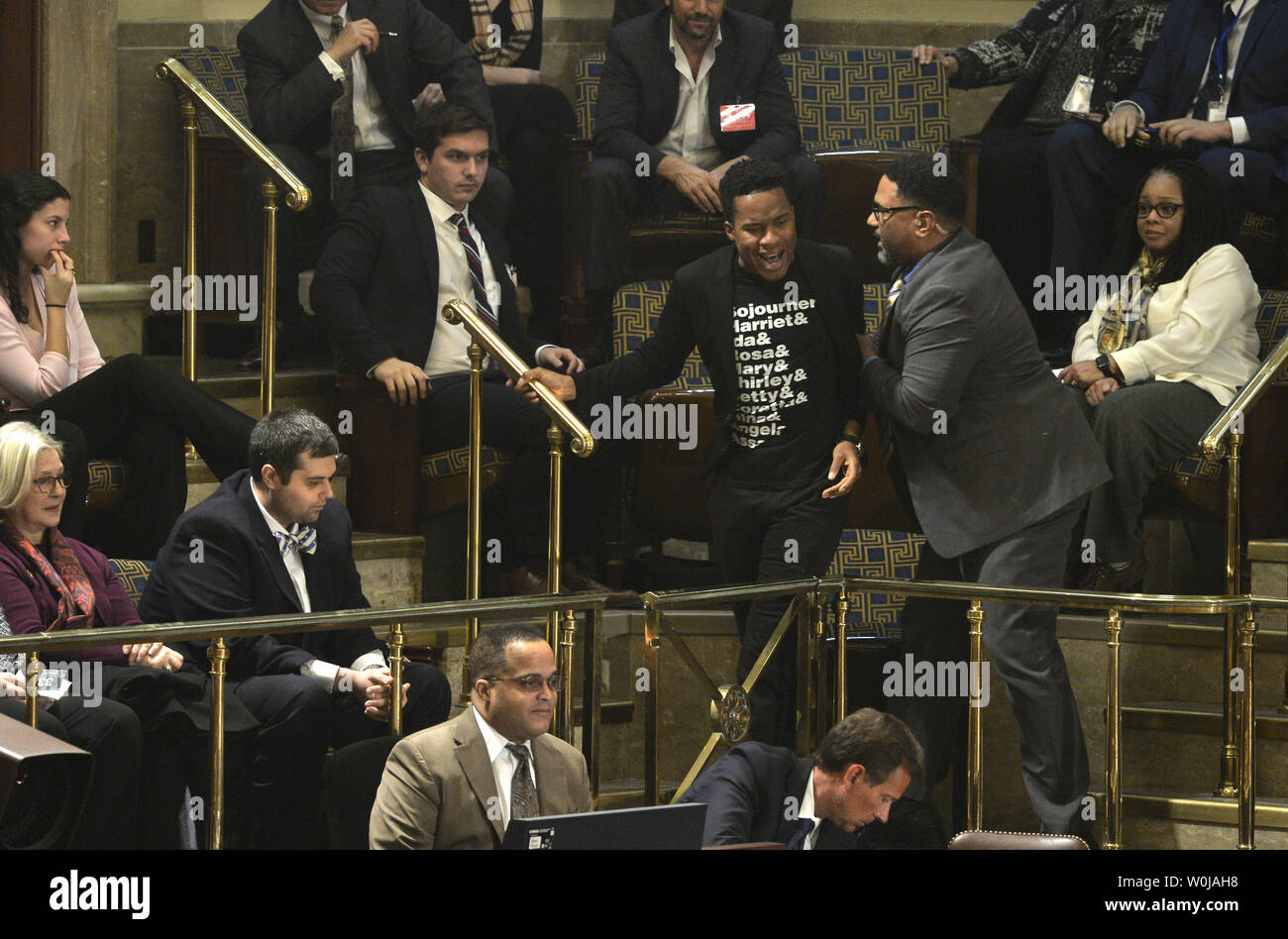A demonstrator shouts in protest as he is removed from the House Gallery during the procedure to count and validate the votes of the Electoral College on the floor of the House at the U.S. Capitol, January 6, 2017, in Washington, DC. She was ruled out of order and the procedure, established by the Constitution, finalized Donald J. Trump and Mike Pence as the president and vice president.                 Photo by Mike Theiler/UPI - Stock Image