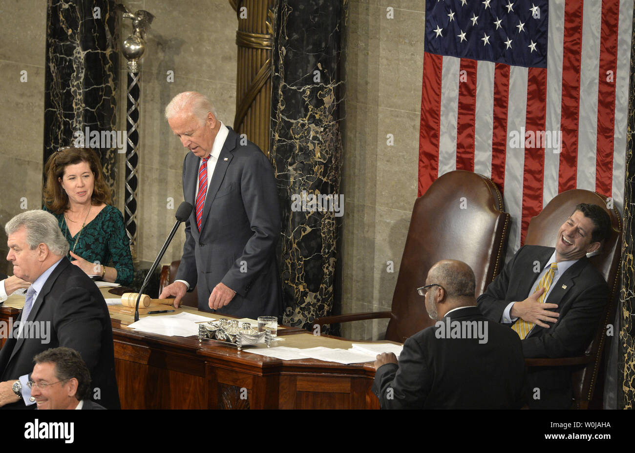 Speaker Paul Ryan (R-WI), (R), reacts in laughter after Vice President Joe Biden (L) said 'It's Over' in response to a floor protest during the procedure to count and validate the votes of the Electoral College on the floor of the House at the U.S. Capitol, January 6, 2017, in Washington, DC. The procedure, established by the Constitution, finalized Donald J. Trump and Mike Pence as the president and vice president.                 Photo by Mike Theiler/UPI - Stock Image