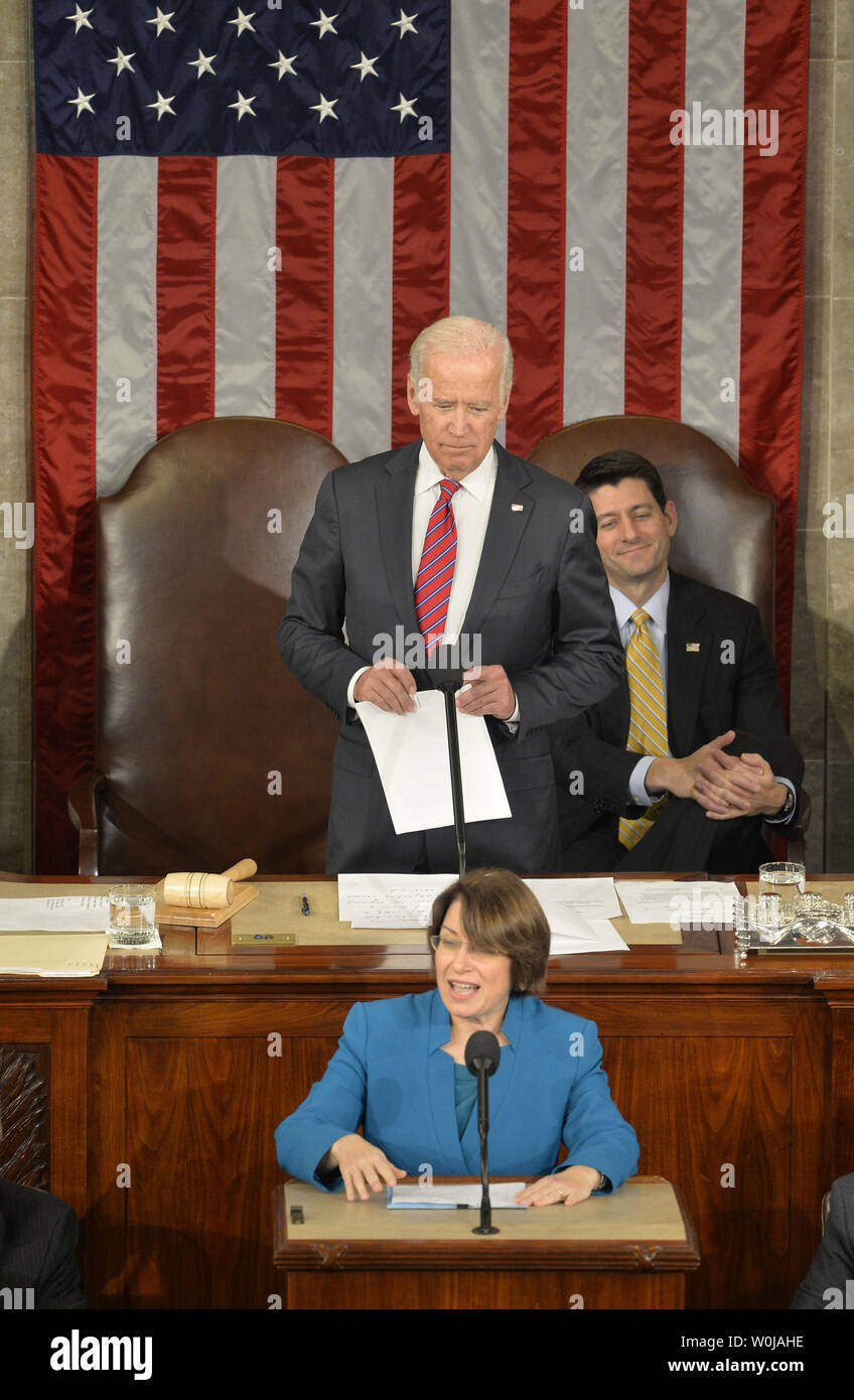 Vice President Joe Biden (C) and Speaker Paul Ryan (R) listen as Sen. Amy Klobuchar (D-MN) validates a state vote as they preside over the procedure to count and validate the votes of the Electoral College on the floor of the House at the U.S. Capitol, January 6, 2017, in Washington, DC. The procedure, established by the Constitution, finalized Donald J. Trump and Mike Pence as the president and vice president.                 Photo by Mike Theiler/UPI - Stock Image