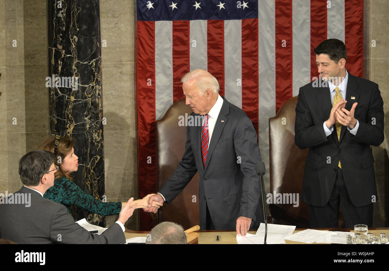 Vice President Joe Biden (C) shakes hands with Congressional staff as Speaker Paul Ryan applauds at the conclusion of the procedure to count and validate the votes of the Electoral College on the floor of the House at the U.S. Capitol, January 6, 2017, in Washington, DC. The procedure, established by the Constitution, finalized Donald J. Trump and Mike Pence as the president and vice president.                 Photo by Mike Theiler/UPI - Stock Image
