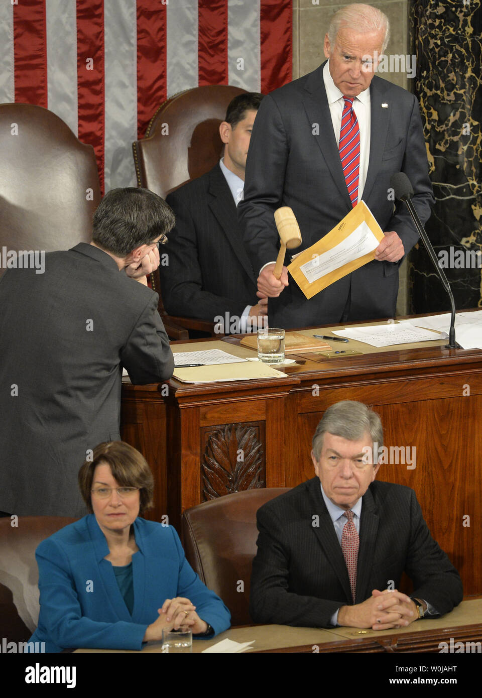 Vice President Joe Biden (TOP) gavels down a floor protest as Sen. Amy Klobuchar (D-MN),(L) and Sen. Roy Blunt (R-MO) listen as they preside over the procedure to count and validate the votes of the Electoral College on the floor of the House at the U.S. Capitol, January 6, 2017, in Washington, DC. The procedure, established by the Constitution, finalized Donald J. Trump and Mike Pence as the president and vice president.                 Photo by Mike Theiler/UPI Stock Photo