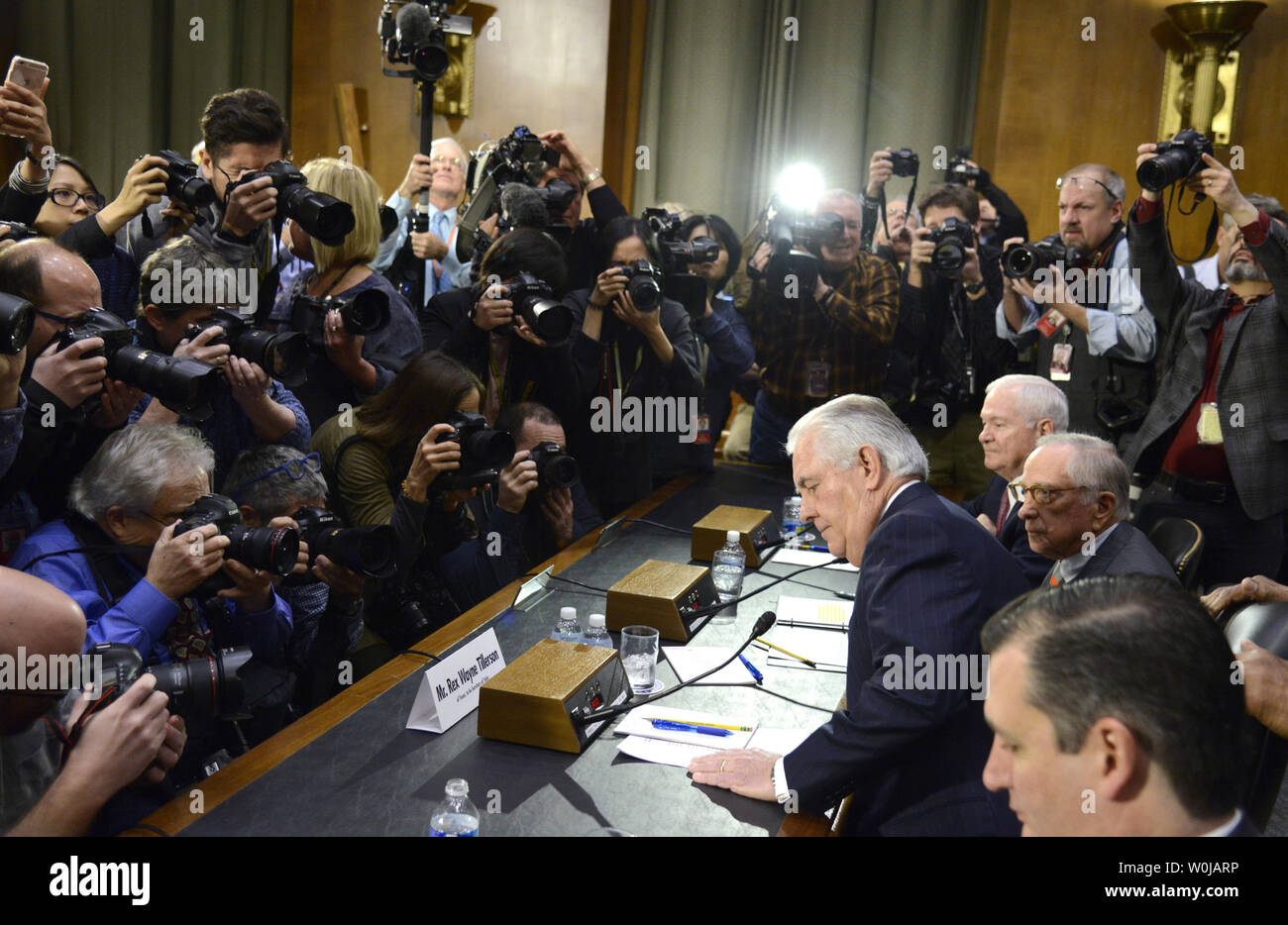 Former ExxonMobil CEO Rex Tillerson, (R), nominated for secretary of state, arrives to face the media's cameras and take his seat prior to his Senate Foreign Relations Committee confirmation hearings, on Capitol Hill, January 11, 2017, in Washington, DC. Tillerson's close business relationship with Russia is expected to be scrutinized by the panel.             Photo by Mike Theiler/UPI - Stock Image