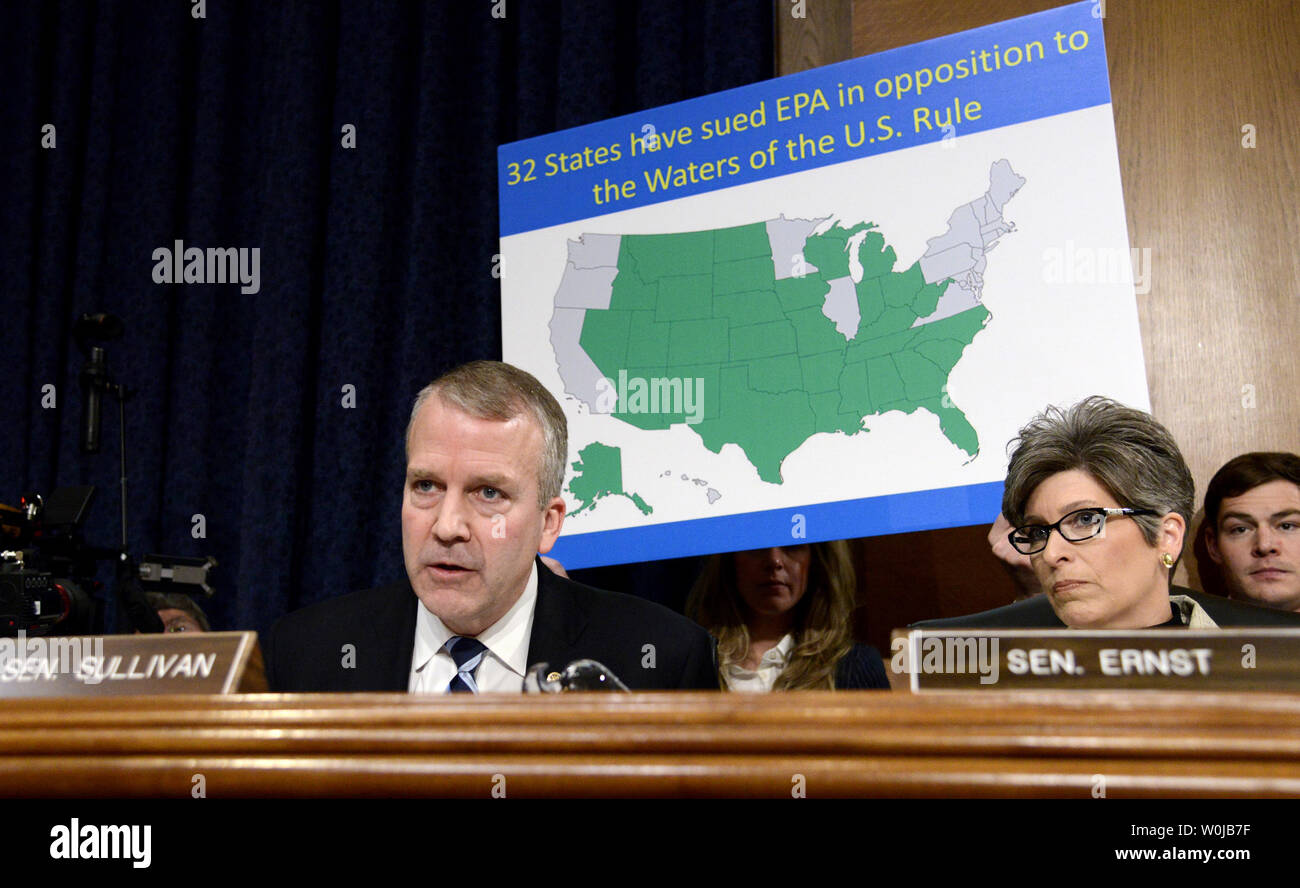 Alaska Sen. Dan Sullivan (L) questions Oklahoma Attorney General Scott Pruitt, nominated to be the next administrator for the EPA, about the number of states who have sued the EPA, as Iowa Sen. Jonie Ernst listens, during Senate Environment and Public Works Committee confirmation hearings, on Capitol Hill, January 18, 2017, in Washington, DC. Democrats on the panel are expected to closely question Pruitt's denial of climate change and his close ties to the gas-and-oil industry.             Photo by Mike Theiler/UPI Stock Photo