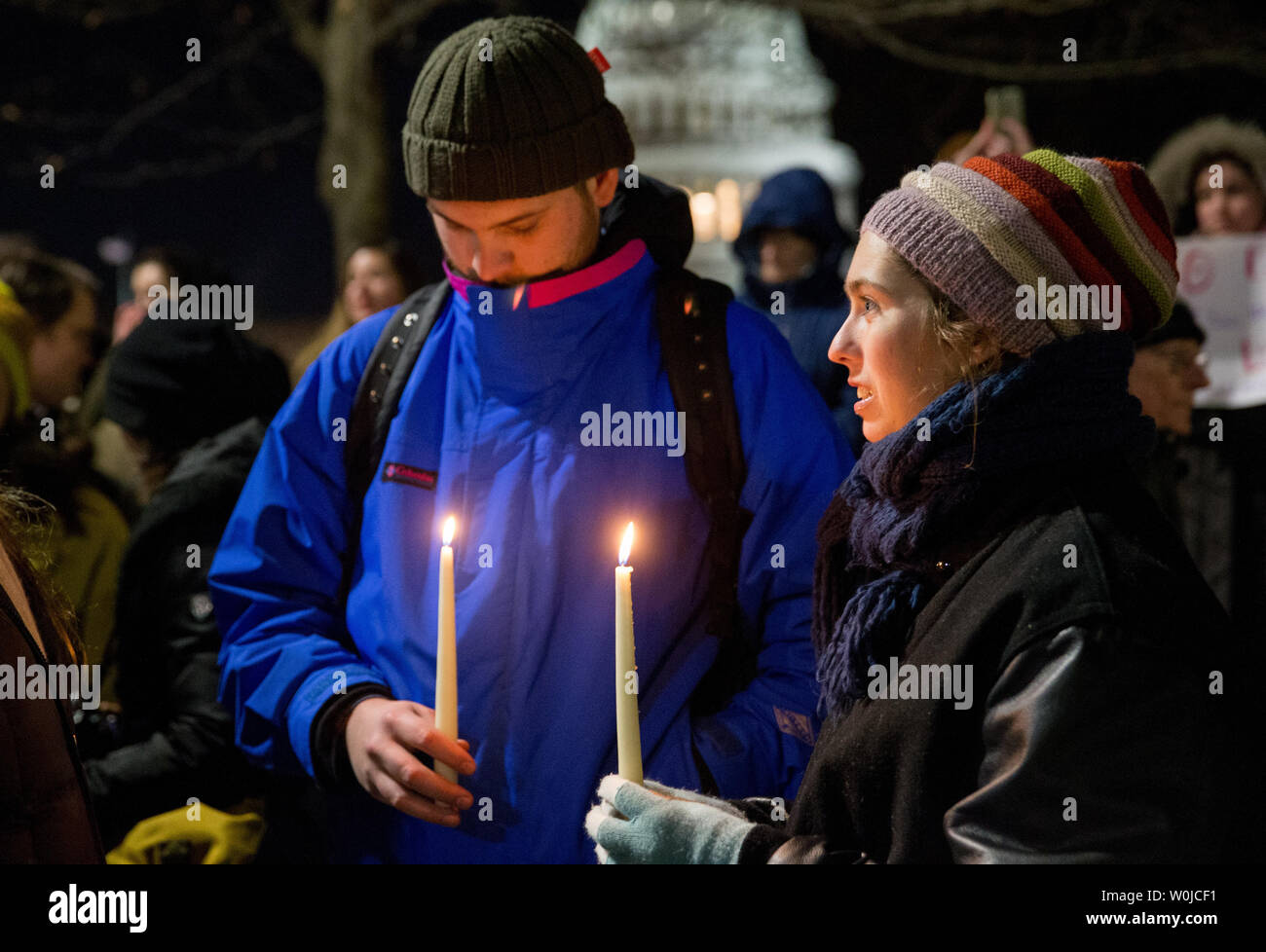 Demonstrators hold candles during a candlelight vigil in front of the U.S. Supreme Court to call on U.S. President Trump to reverse his administration's recent anti-refugee and anti-immigrant executive orders that bar for 90 days people traveling from Iraq, Iran, Sudan Syria, Yemen, Libya and Somalia to the United States in Washington, DC on January 30, 2017. President Trump's executive orders additionally suspend processed refugee admissions for Syrians for 120 days and any new refugee applications and admissions for Syrian refugees to be banned indefinitely.        Photo by Erin Schaff/UPI - Stock Image