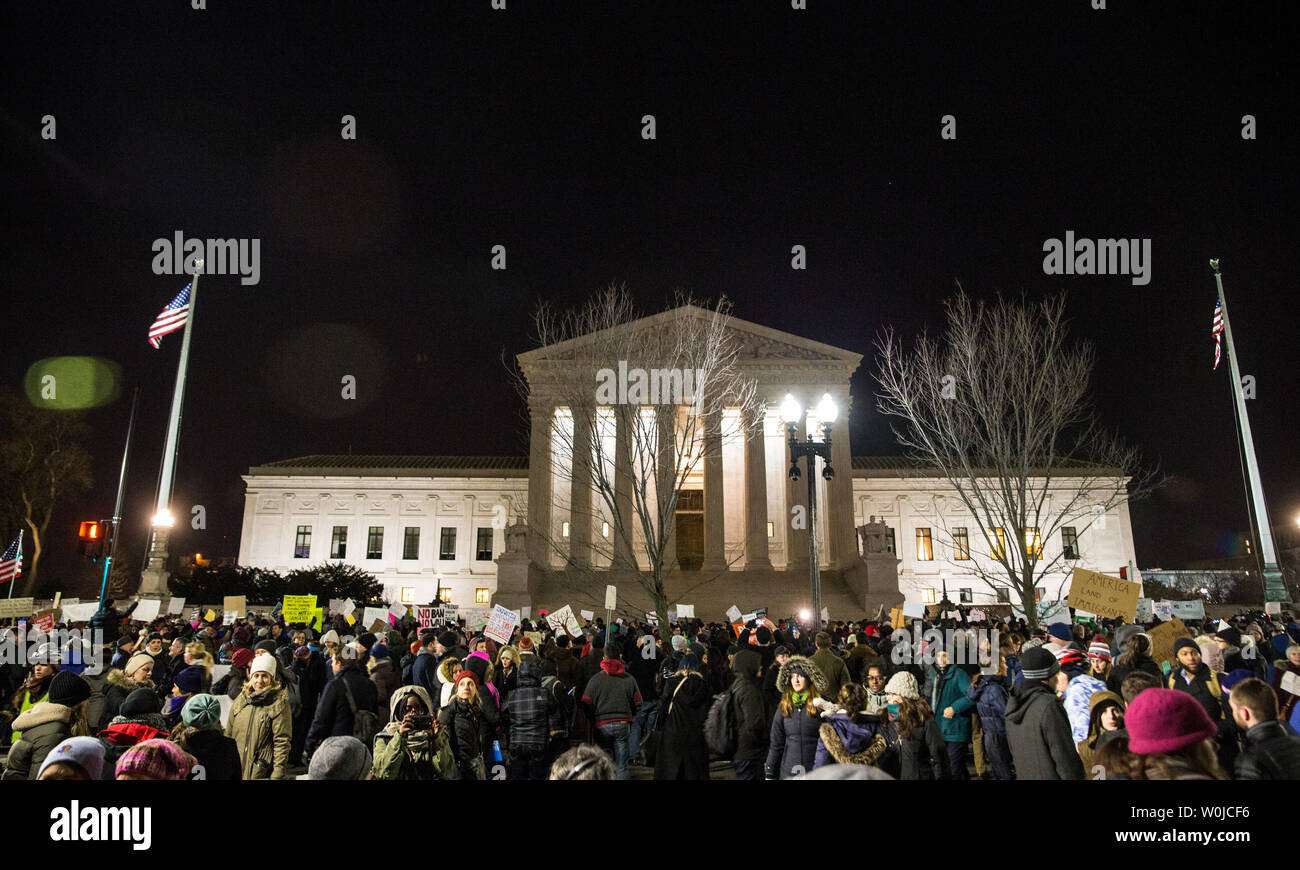 Protesters demonstrate in front of the U.S. Supreme Court to call on U.S. President Trump to reverse his administration's recent anti-refugee and anti-immigrant executive orders that bar for 90 days people traveling from Iraq, Iran, Sudan Syria, Yemen, Libya and Somalia to the United States in Washington, DC on January 30, 2017. President Trump's executive orders additionally suspend processed refugee admissions for Syrians for 120 days and any new refugee applications and admissions for Syrian refugees to be banned indefinitely.        Photo by Erin Schaff/UPI - Stock Image