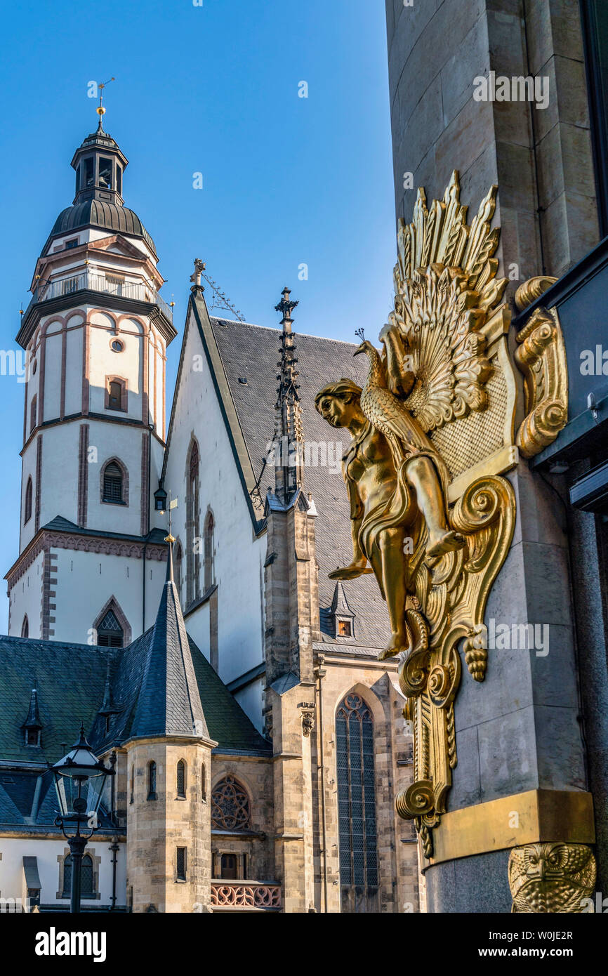 St Thomas Church, golden sculpture, Leipzig, Saxony, Germany | St Thomaskirche, vergoldete Statue, Leipzig, Sachsen - Stock Image