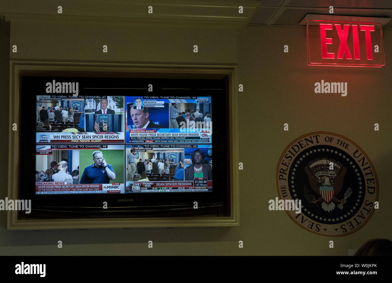 A TV displays four channels of breaking news on the
