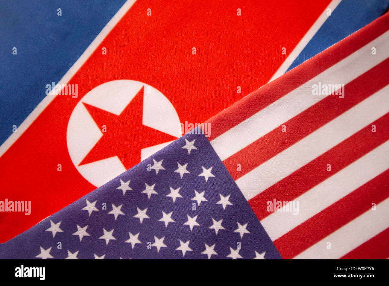 Concept of Bilateral relationship between two countries showing with two flags: United States of America and North Korea - Stock Image