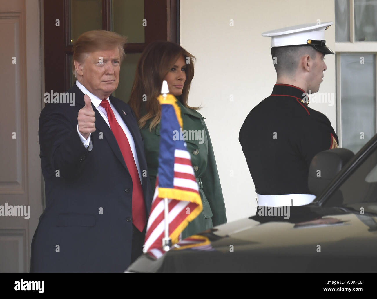 President Donald Trump gives a thumbs up to the press as he and First Lady Melania Trump bid goodbye to Czech Prime Minister Andrej Babis as he departs the White House, March 7, 2019, in Washington, DC. The Czech Republic is a member of NATO, and talks were expected to include the conflict in Syria.      Photo by Mike Theiler/UPI - Stock Image