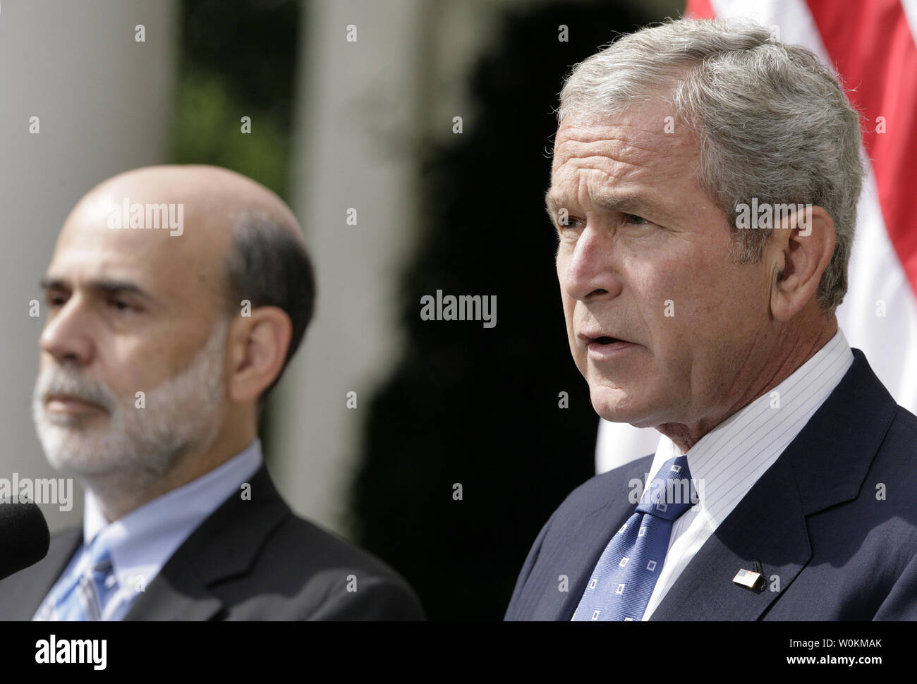 U S  President George W  Bush (R) jointed by Federal Reserve