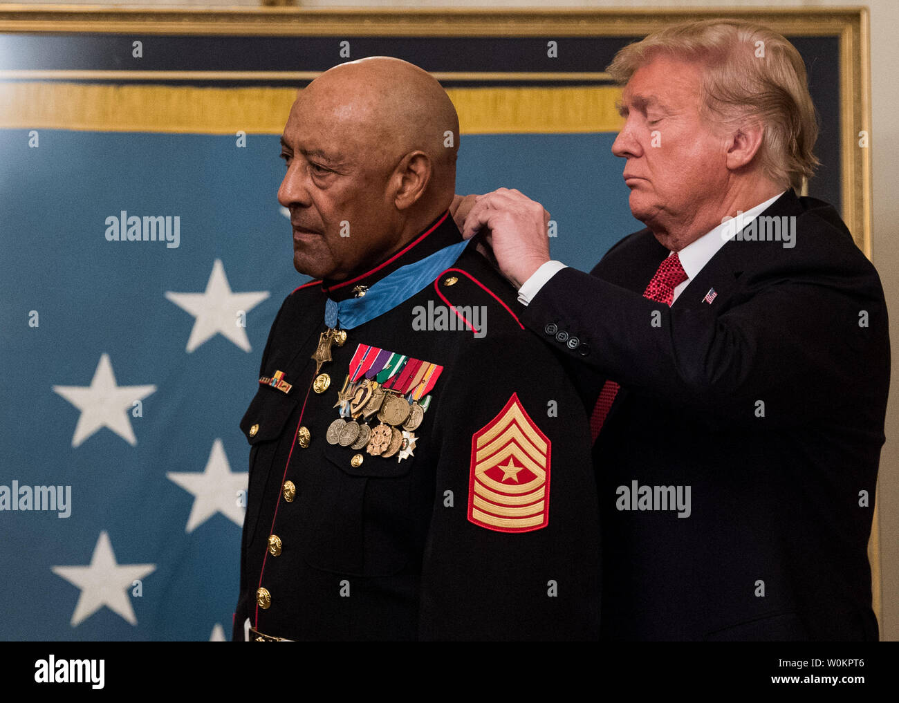 President Donald Trump awards the Medal of Honor to Sgt. Major John L. Canley, a retired member of the U.S. Marine Corps, during a ceremony at the White House in Washington, D.C. on October 17, 2018. Canley was honored for his heroic actions in Vietnam War in 1968. Photo by Kevin Dietsch/UPI Stock Photo