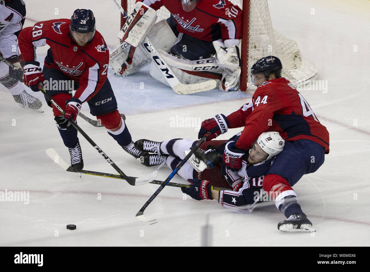 Capitals defenseman Jakub Jerabek (28) skates for a loose puck while Capitals defenseman Brooks Orpik (44) checks Blue Jackets center Pierre-Luc Dubois (18) during the first round NHL playoff game between the Columbus Blue Jackets and Washington Capitals at Capital One Arena in Washington, D.C. on April 15 2018. Photo by Alex Edelman/UPI Stock Photo