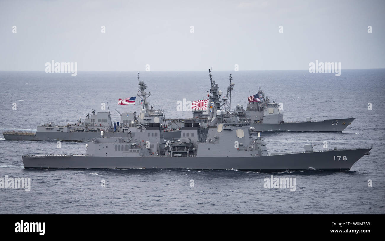 The Japan Maritime Self-Defense Force destroyer JS Ashigara (DDG 178), foreground, the Arleigh Burke-class guided-missile destroyer USS Wayne E. Meyer (DDG 108) and the Ticonderoga-class guided-missile cruiser USS Lake Champlain (CG 57) transit the Philippine Sea on April 28, 2017. The U.S. Navy has patrolled the Indo-Asia-Pacific routinely for more than 70 years promoting regional peace and security. Photo by MC2 Z.A. Landers/U.S. Navy/UPI Stock Photo