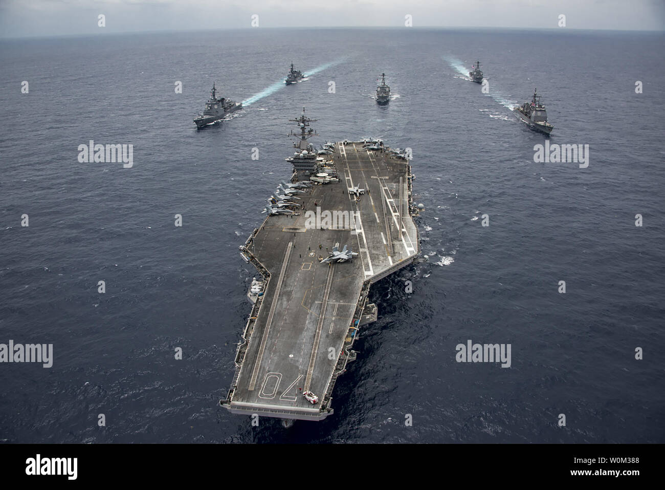 The Nimitz-class aircraft carrier USS Carl Vinson (CVN 70) leads the Japan Maritime Self-Defense Force destroyers JS Ashigara (DDG 178), left front, and JS Samidare (DD 106), left rear, the Arleigh Burke-class guided-missile destroyers USS Michael Murphy (DDG 112), center rear, and USS Wayne E. Meyer (DDG 108), right rear, and the Ticonderoga-class guided-missile cruiser USS Lake Champlain (CG 57), right front, during a transit the Philippine Sea on April 28, 2017. The U.S. Navy has patrolled the Indo-Asia-Pacific routinely for more than 70 years promoting regional peace and security. Photo by Stock Photo