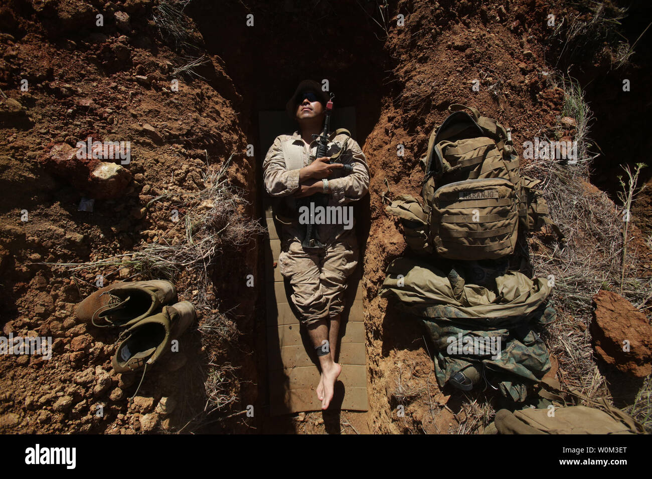Lance Cpl. Andrew Naranjo, a rifleman with 2nd platoon, Company L, 3rd Battalion, 4th Marine Regiment, 1st Marine Division, Marine Rotational Force Darwin, lies in his fighting hole during Exercise Brolga Strike, on June 5th, 2017, in Queensland, Australia. Marines with 3rd Bn., 4th Marines, hiked more than 100 kilometers during the first week of exercise. Marines trained with Australian Defence Forces during the two-week brigade certification exercise. Photo by Cpl. Nathaniel Cray/U.S. Marine Corps/UPI Stock Photo