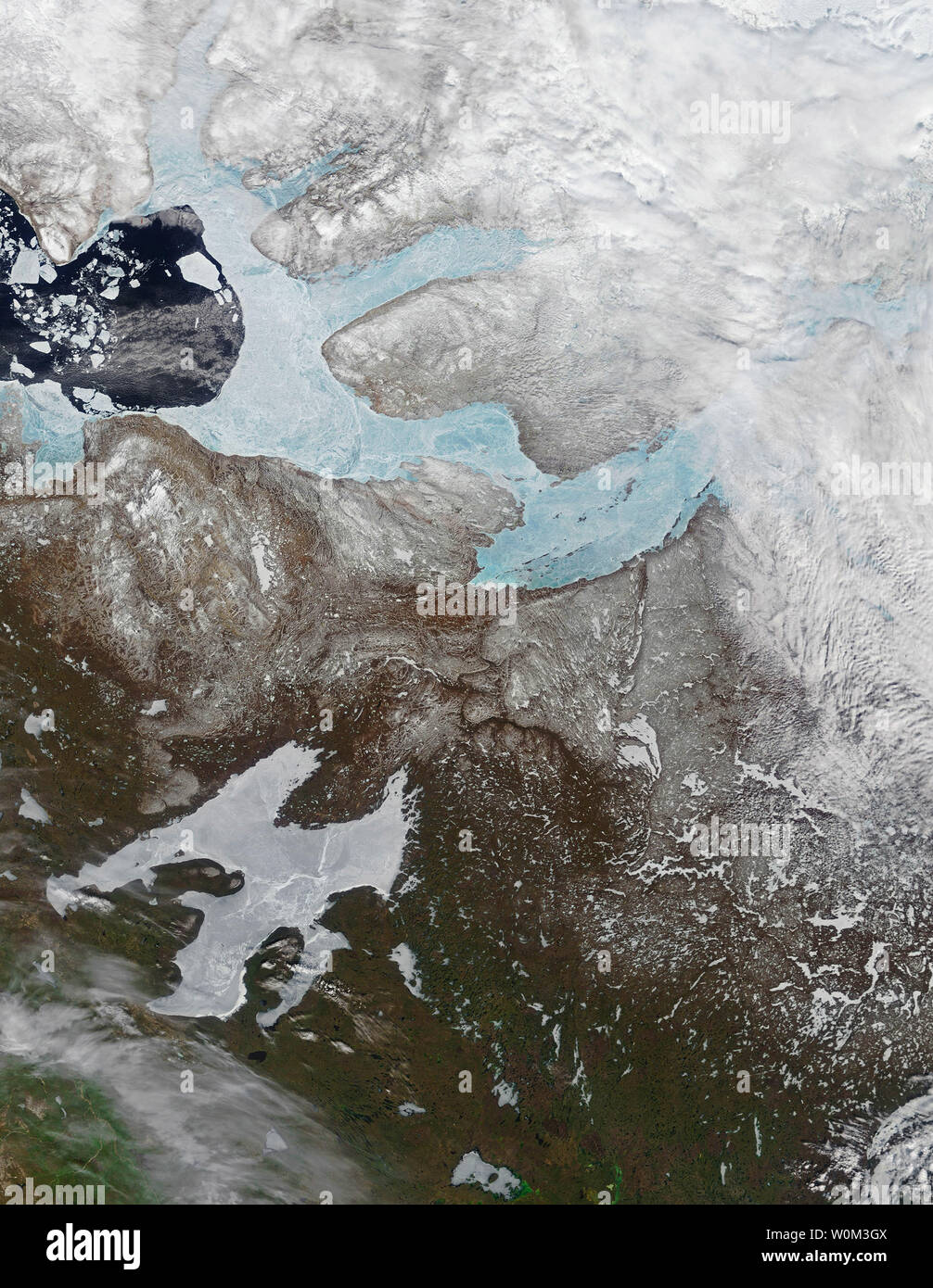 On May 29, 2017, the Moderate Resolution Imaging Spectroradiometer (MODIS) on NASA's Terra satellite captured this image of ice covering the Amundsen Gulf, Great Bear Lake, and numerous small lakes in the northern reaches of Canada's Northwest Territories and Nunavut. Sea ice generally forms in the Gulf of Amundsen in December or January and breaks up in June or July. Lake and river ice in this area follow roughly the same pattern, though shallow lakes freeze up earlier in the fall and melt earlier in the spring than larger, deeper lakes. NASA/UPI - Stock Image