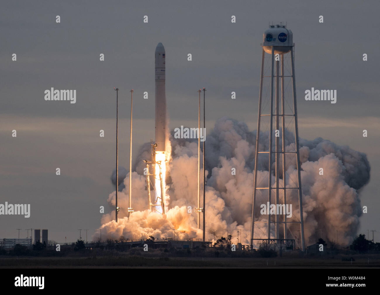 The Orbital ATK Antares rocket, with the Cygnus spacecraft onboard, launches from Pad-0A, on November 12, 2017 at NASA's Wallops Flight Facility in Virginia. Orbital ATK's eighth contracted cargo resupply mission with NASA to the International Space Station will deliver approximately 7,400 pounds of science and research, crew supplies and vehicle hardware to the orbital laboratory and its crew. NASA Photo by Bill Ingalls/UPI Stock Photo